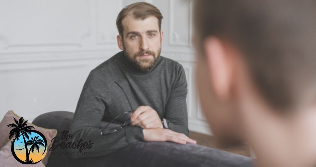 substance abuse counselor talking to his patient